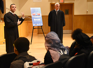 Photo of Judge Valleriani and Judge Demarco speaking with students