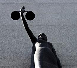 Photo of Lady Justice holding Scales of Justice