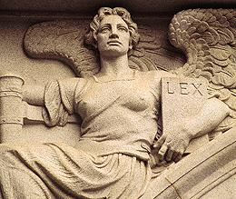 Photo of architectural relief, Angel holding book titled LEX.