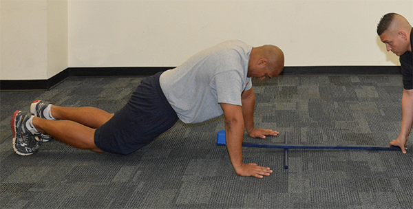 man doing pushup without body in alignment